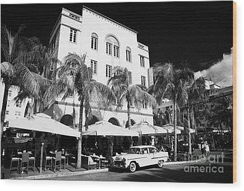 Orange Chevrolet Bel Air In The Cuban Style Outside The Edison Hotel Wood Print by Joe Fox