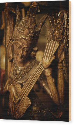 Wood Print featuring the photograph Oriental Wooden Princess Playing Instrument by Dave Garner