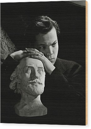 Orson Welles Resting On A Sculpture Wood Print by Cecil Beaton