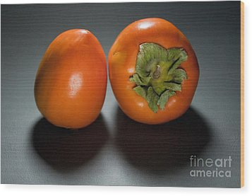 Pair Of Persimmons Wood Print by Dan Holm
