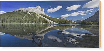 Panorama Of A Mountains Reflecting On A Wood Print by Michael Interisano