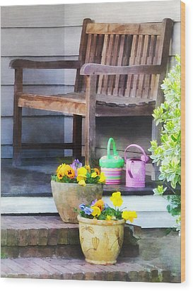 Pansies And Watering Cans On Steps Wood Print by Susan Savad
