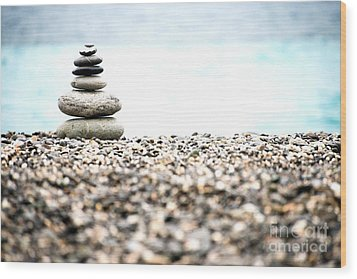 Pebble Stone On Beach Wood Print by Yew Kwang