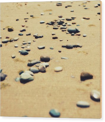 Pebbles On The Beach Wood Print by Michelle Calkins