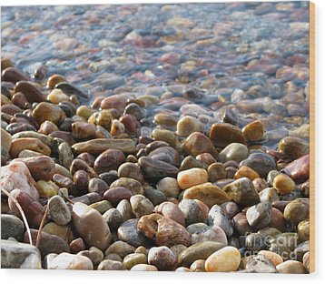 Pebbles On The Shore Wood Print by Leone Lund