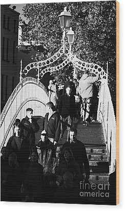 People Crossing The Hapenny Ha Penny Bridge Over The River Liffey In Dublin At A Busy Time Vertical Wood Print by Joe Fox