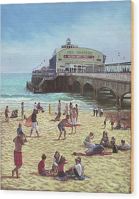 people on Bournemouth beach Pier theatre Wood Print by Martin Davey