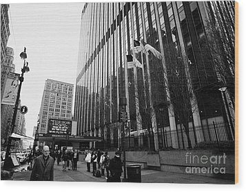 people on the sidewalk outside madison square garden with US flags flying new york city Wood Print by Joe Fox