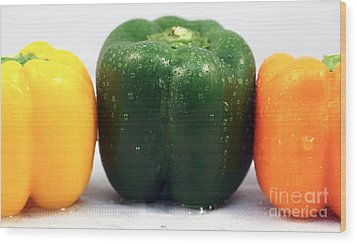 Pepper Colors Wood Print by John Rizzuto