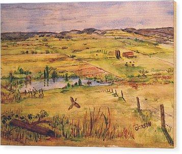 Pheasant In Flight Wood Print by Blaine Benson