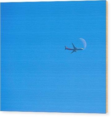 Plane Crossing The Moon Wood Print