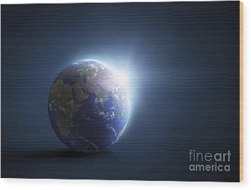 Planet Earth And Sunlight On A Dark Wood Print by Evgeny Kuklev