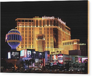 Planet Hollywood At Night Wood Print by John Rizzuto