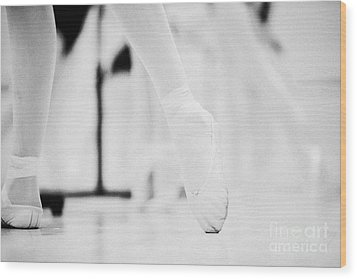 Pointed Toe In Ballet Slippers At A Ballet School In The Uk Wood Print by Joe Fox
