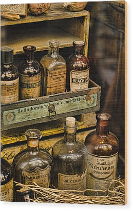 Potions And Cure Alls Wood Print by Heather Applegate
