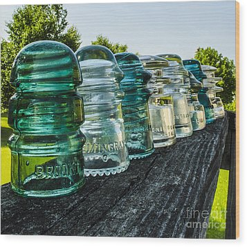 Pretty Glass Insulators All In A Row Wood Print