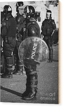 Psni Officer In Full Riot Gear With Shield On Crumlin Road At Ardoyne Shops Belfast 12th July Wood Print by Joe Fox