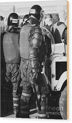 Psni Officer In Riot Gear With Shield And Baton On Crumlin Road At Ardoyne Shops Belfast 12th July Wood Print by Joe Fox