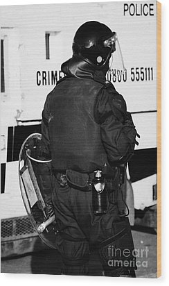 Psni Officer With Riot Gear On Crumlin Road At Ardoyne Shops Belfast 12th July Wood Print by Joe Fox