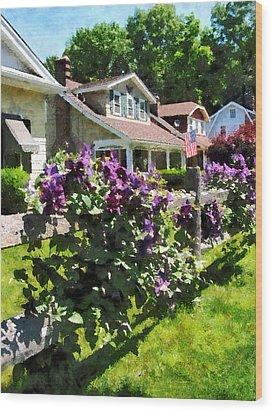 Purple Clematis On Rustic Fence Wood Print by Susan Savad