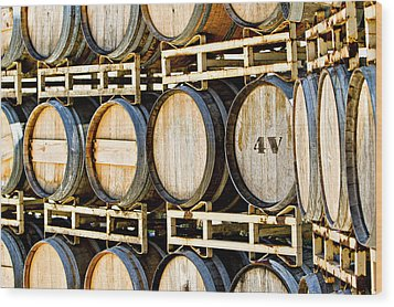 Rack Of Old Oak Wine Barrels Wood Print by Susan Schmitz