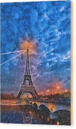 Rain Falling On The Eiffel Tower At Night In Paris Wood Print by Mark E Tisdale