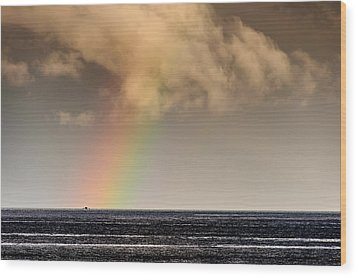 Rainbow Over A Black Ocean Wood Print by Colin Utz