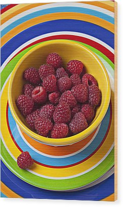 Raspberries In Yellow Bowl On Plate Wood Print by Garry Gay