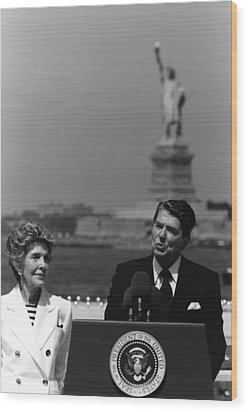 Reagan Speaking Before The Statue Of Liberty Wood Print by War Is Hell Store