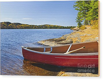 Red Canoe On Shore Wood Print by Elena Elisseeva