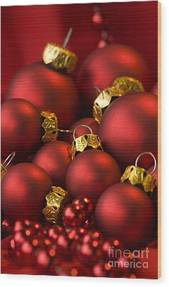 Red Christmas Baubles Wood Print by Anne Gilbert
