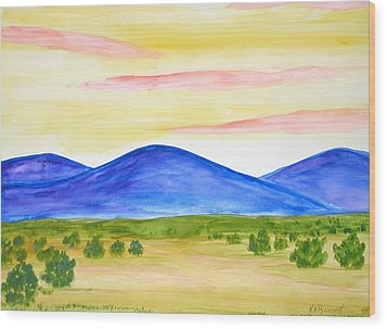 Red Clouds Over Mountains Wood Print