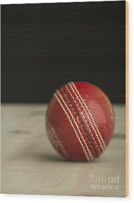 Red Cricket Ball Wood Print by Edward Fielding