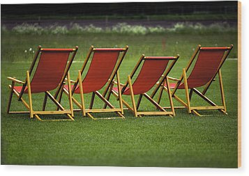 Red Deck Chairs On The Green Lawn Wood Print by Mikhail Pankov