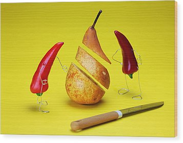 Red Peppers Sliced A Pear Wood Print by Paul Ge