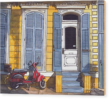 Red Scooter With Yellow House And Blue Shutters Wood Print by John Boles