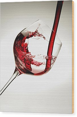 Red Wine Pouring Into A Glass Wood Print by Richard Desmarais