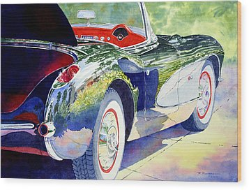 Reflections On A Corvette Wood Print by Roger Rockefeller
