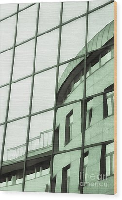 Reflections On The Building Wood Print by Odon Czintos