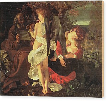 Rest On The Flight Into Egypt Wood Print by Caravaggio