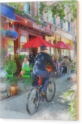 Riding Past The Cafe Wood Print by Susan Savad