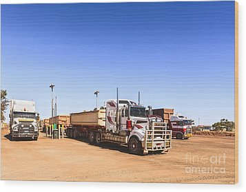 Road Trains Refuelling Wood Print by Colin and Linda McKie