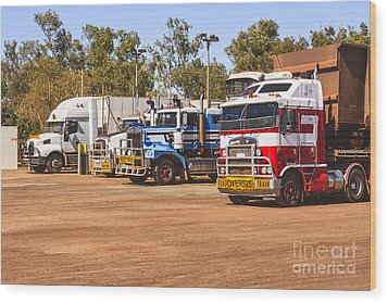 Road Trains Taking On Gas Or Diesel Wood Print by Colin and Linda McKie