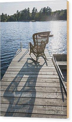 Rocking Chair On Dock Wood Print by Elena Elisseeva