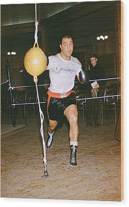 Rocky Marciano Striking Bag Wood Print by Retro Images Archive