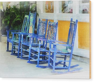 Row Of Blue Rocking Chairs Wood Print by Susan Savad