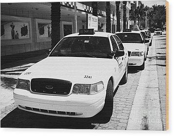 Row Of Yellow Cab Taxis In Miami South Beach Florida Usa Wood Print by Joe Fox