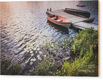 Rowboat At Lake Shore At Sunrise Wood Print by Elena Elisseeva