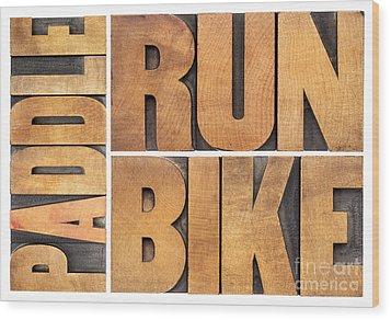 Wood Print featuring the photograph Run Bike Paddle - Triathlon Concept by Marek Uliasz