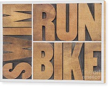 Wood Print featuring the photograph Run Bike Swim - Triathlon Concept by Marek Uliasz